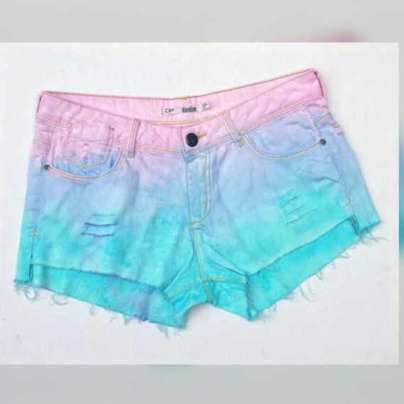 Pastel goth denim shorts, ripped style in blue & pale pink. Custom made to order, all sizes available. Whether chilling at a music festival or at a Christmas party, these striking, denim shorts with their pastel blue and pink ombre colours and distressed style will ensure you stand out from the crowd.  Upcycled & hand dyed from pre-owned jeans that I picked up in a thrift store ... remade with love by AbiDashery.  Available in sizes: UK 6 or US 2 UK 8 or US 4 UK 10 or US 6 UK 12 or US 8 UK…