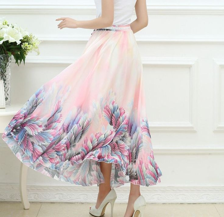 A chiffon maxi skirt features an elastic waistband with feather decorations, overall print and loose silhouette. It has versatile design that can be worn as skirt or cover up this summer. Flowy and ai