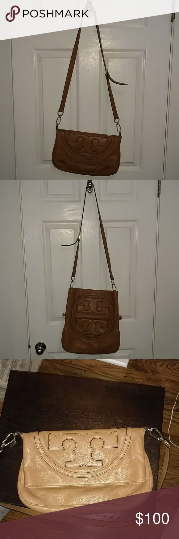 Tory Burch convertible fold-over cross body purse Gently used, saddle brown rich peddle leather convertible fold-over cross body purse with Tory Burch dust bag. Purse can be worn three ways - over the shoulder, cross body and as a clutch when strap is removed.  Strap can be worn two ways - at center of bag for folded over (more secure look) or at opening to provide easier access to contents of bag and to carry more.  Great for summer errands, festivals and casual date nights. Tory Burch Bags…