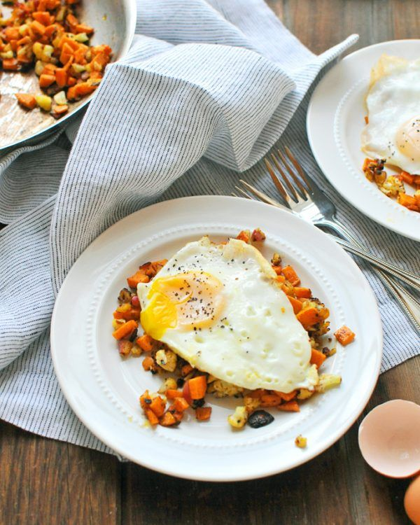 Cauliflower & Sweet Potato Hash with Fried Eggs is a naturally gluten free and paleo friendly breakfast idea!