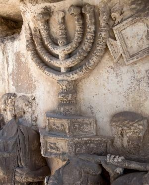 The menorah, originally painted a rich yellow, on the Arch of Titus in the Roman Forum.