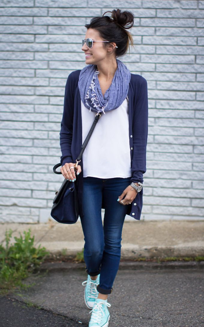 Looks like a casual Friday outfit with sneakers and a scarf