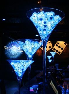 LED Martini glass centerpieces. Perfect for casino night table decorations. Find everything you need to plan your own James Bond Casino Royale Party at http://sparklerparties.com/casino-royale/