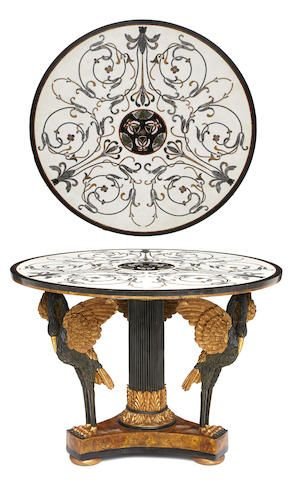 A Neoclassical style pietra dura, marble and composition parcel gilt center table. The marble top decorated with butterflies and scrolling foliage. height 32in; diameter 45in