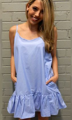 Freya Ruffle Dress by SAN JOSE features a scoop neckline with adjustable spaghetti straps and a ruffle bottom. The women's dress has a relaxed fit with a hemlie that comes down to approximately above the knee. Available in sky blue.