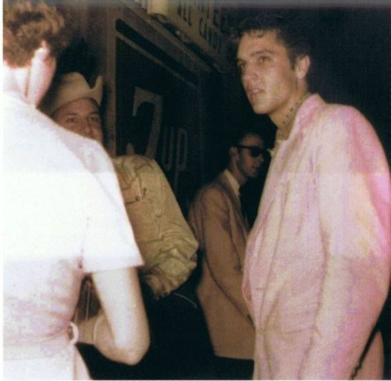"""Elvis Presley backstage at the Louisiana Hayride, Shreveport, Louisiana, with Jim Reeves and pianist, Leon Post (wearing sunglasses), June 11, 1955. > JUNE 11, 1955 SATURDAY Elvis Presley returned to Shreveport and the """"Louisiana Hayride"""", he lacked his normal energy. After Elvis Presley closed the show with """"That's All Right"""", he complained to Scotty Moore and Bill Black that he was tired."""