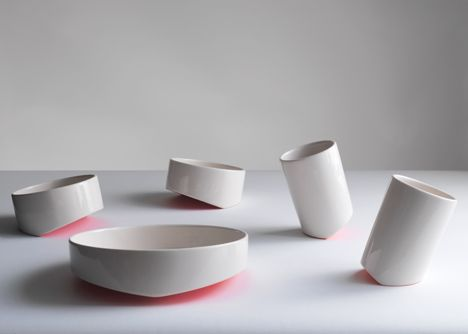 Share.Food tableware by Saltik features a small bowl, a large plate and a cup, each with a v-shaped base.