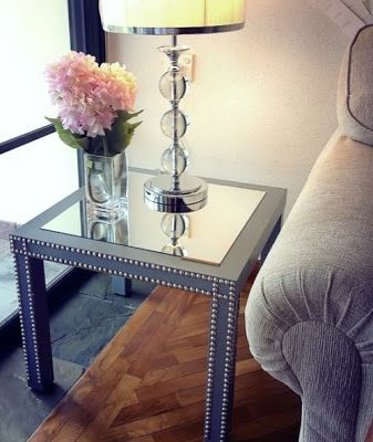This is just a $7 ikea side table, painted with push pins and a mirror.
