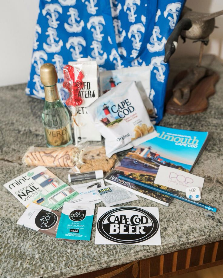 Ultimate wedding welcome bag www.bettertogivegifts.com so many amazing wedding favors for our cape cod guests lobster lollipops cape cod chips little Debbie pop jewelry earrings lip balm smith and change oriental trading company nautical bag navy Verdi champagne Falmouth guide cape cod beer all good lotion sunscreen Shoe wipes