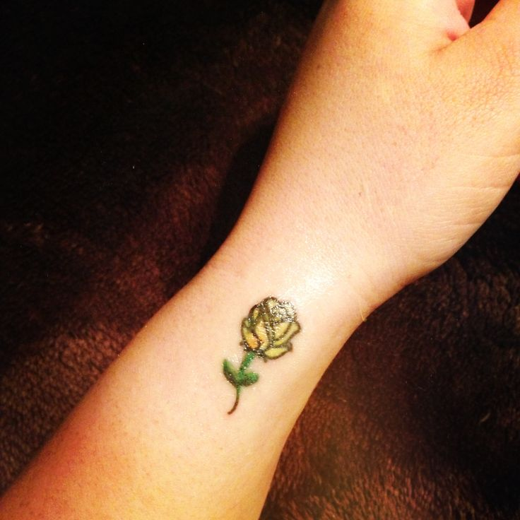 Small yellow rose tattoo, but I would personally do red. It's still cute though! :)