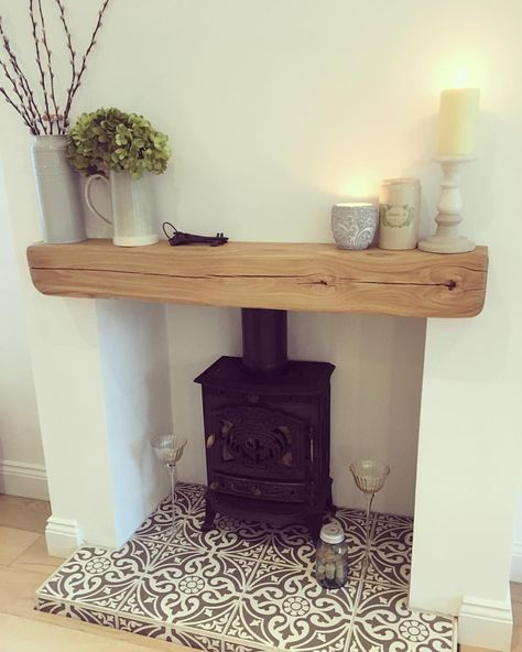 O C T O B E R is here and the candles are lit!!!! #cosy #candles #october #homedecor #houseremodel #houserenovation #homedesign #fireplace #logburner #mantle #mantledecor #tiles #hearth #tiledhearth