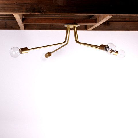 Brass ceiling light made by onefortythree. Three- and four-arm versions. Natural brass, 300 watt bulbs in each.