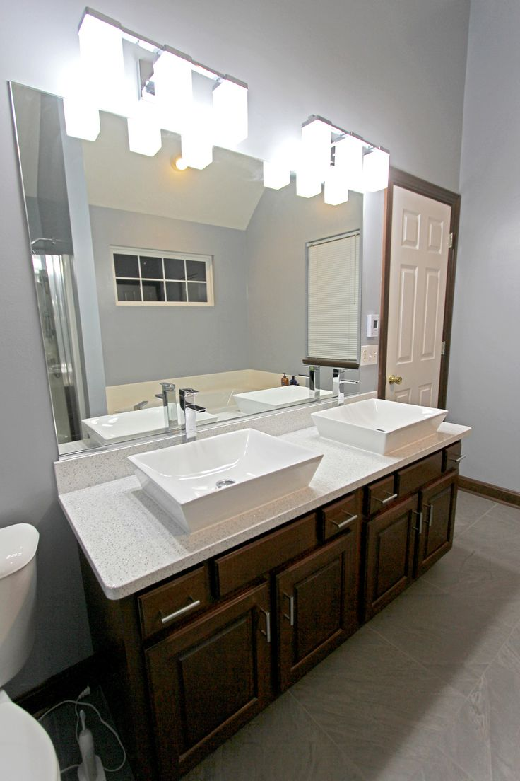 Bathroom Light Fixtures >> This master bathroom was updated with new Cambria Whitney quartz countertops on the existing ...