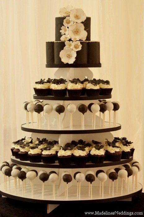 http://madelinesweddings.com/blog/fabulous-featured-submissions/fabulous-featured-submissions-bloom-cake-co/www.bloomcakeco.com   Love the combo of cupcakes, cake pops, and the cake topper for us to cut!