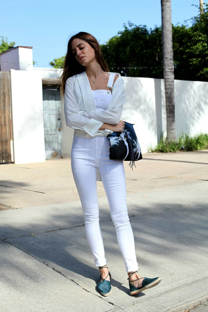 Gala Gonzalez of Amlul wearing white overalls with espadrilles