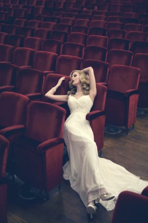 What's more luxurious: the dress or the movie theatre to herself?