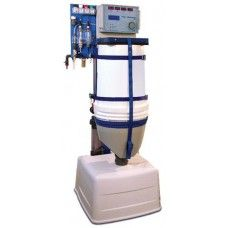 Granudos 100 TOP swimming pool disinfection system uses IQ Granu-Chlor 700 granulated Calcium Hypochlorite and IQ Granu-cid acid with optional flocculant dosing controlled by TOP CONTROL MC for free chlorine, pH, redox and temperature.