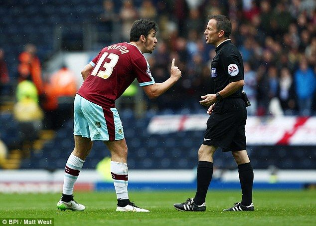 Blackburn Rovers 0 Burnley 1: the ever voluble Joey Barton argues with referee Keith Stroud after a controversial decision.