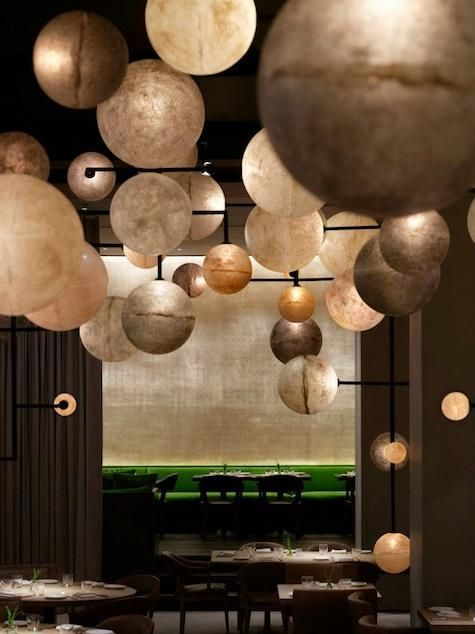 The lighting installation in the Pump Room by Milan's Dilmore Studio features 500 individually cast resin globes of different sizes and finishes.