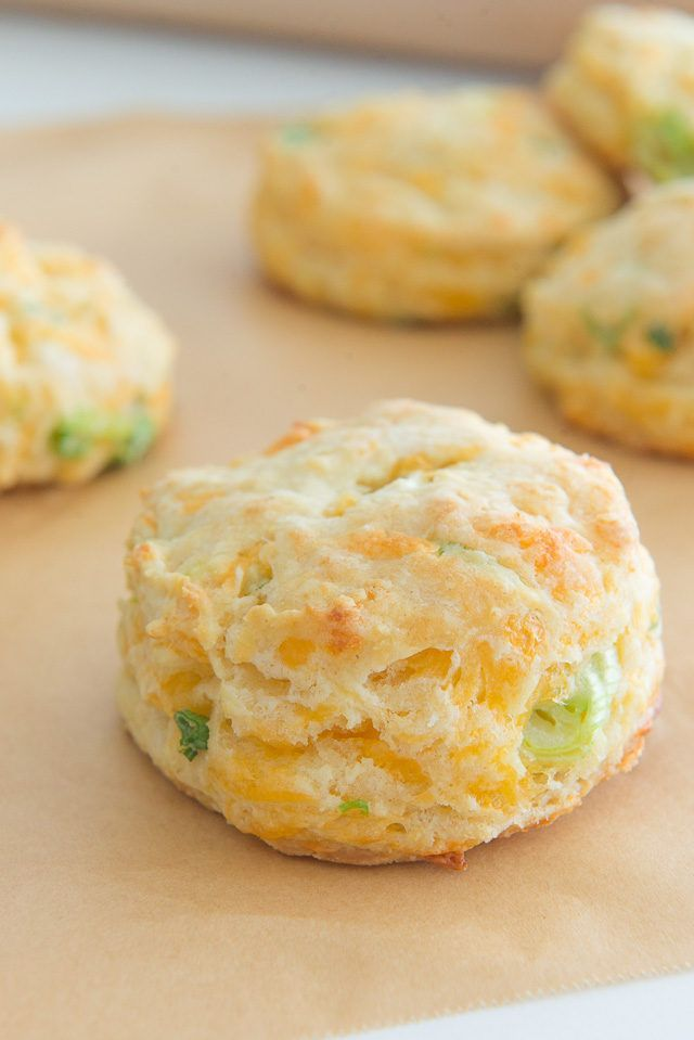 Super Cheesy Cheddar Scallion Biscuits! Made with butter and buttermilk (no shortening), they're flaky and soft.