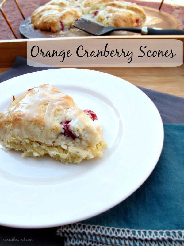 Orange Cranberry Scones - moist and delicious orange scones with fresh cranberries and orange glaze. Perfect for a cold morning!