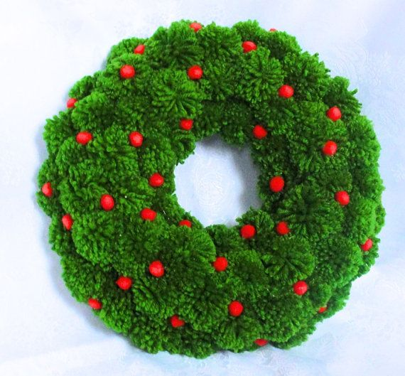 Green pom pom Christmas tree. The decoration of the tree is small red felt baubles. On the second photo, you see a matching pompom wreath - great set for coming Christmas.  Height: 22 cm Width at the bottom: 16 cm  If you wish to buy more products from my shop - please contact - we will agree the best shipping solution for you.   Back to my shop: www.pompommyworld.etsy.com  Thank you for the visit!  Let me Pom Pom Your World!  IMPORTANT: For Europe - Christmas decoration can be ordered max…