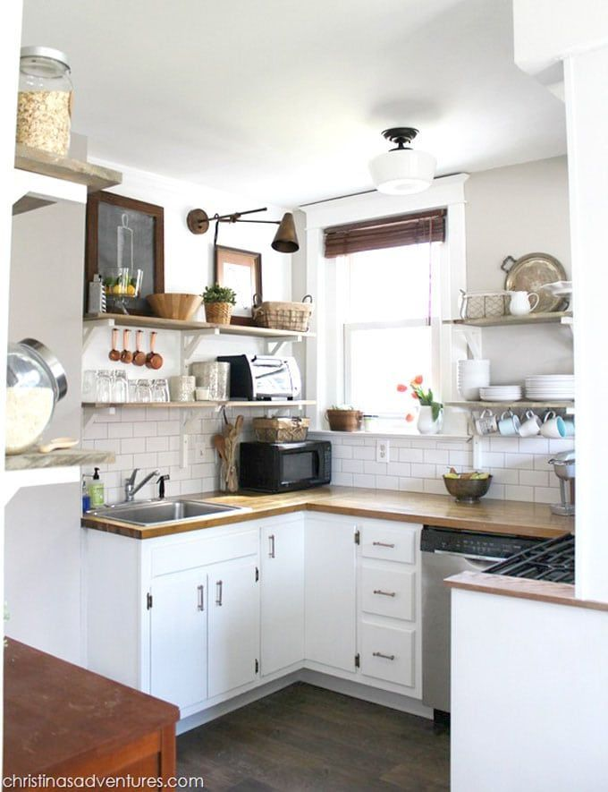 You won't believe the before photos of this DIY beautiful farmhouse kitchen remodel! 15 Best kitchen remodel ideas & before and afters: how to paint kitchen cabinets, add open shelving, select backsplash, hardware, lighting, kitchen decorations, and styles from farmhouse to modern! – A Piece of Rainbow