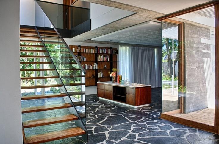 Steel, wood, stair, stone floor, concrete walls