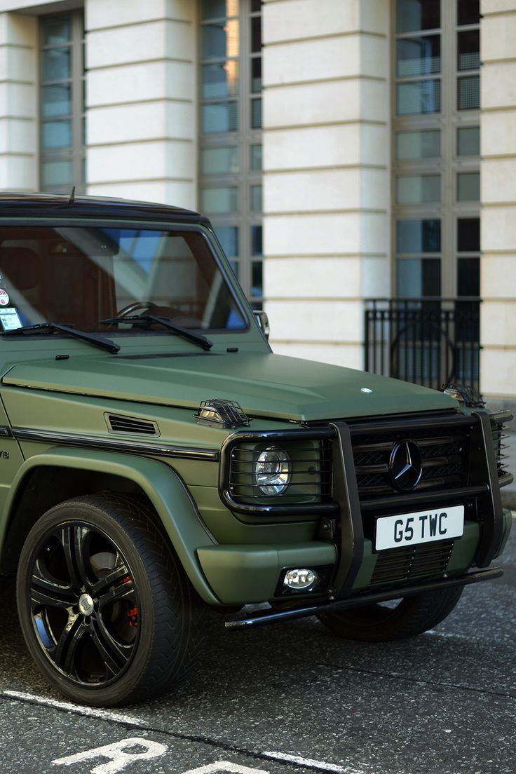 Mecedes-Benz G Class in forest green suite,creating stunning contrast with…