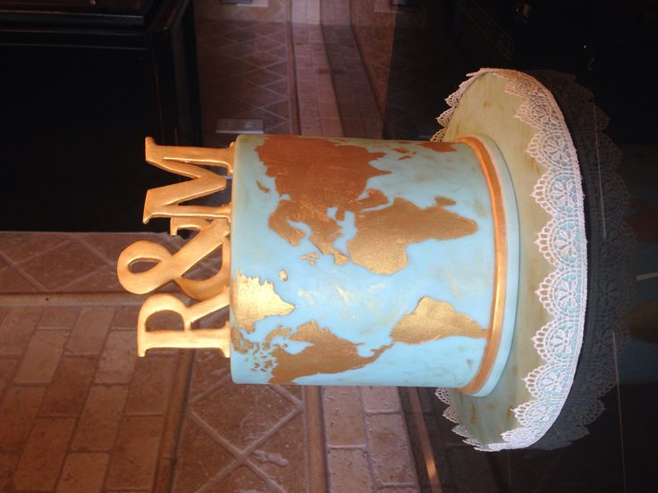 Vintage, blue and gold world map themed anniversary cake.