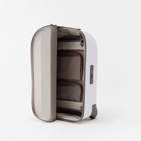 Japanese studio Nendo has designed a cabin-size suitcase with a fabric lid that unzips from the top and rolls back to the side for easier access //