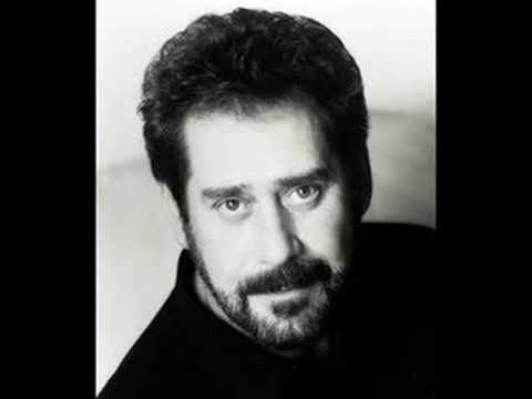A little old country...Earl Thomas Conley's Holding her and Loving You