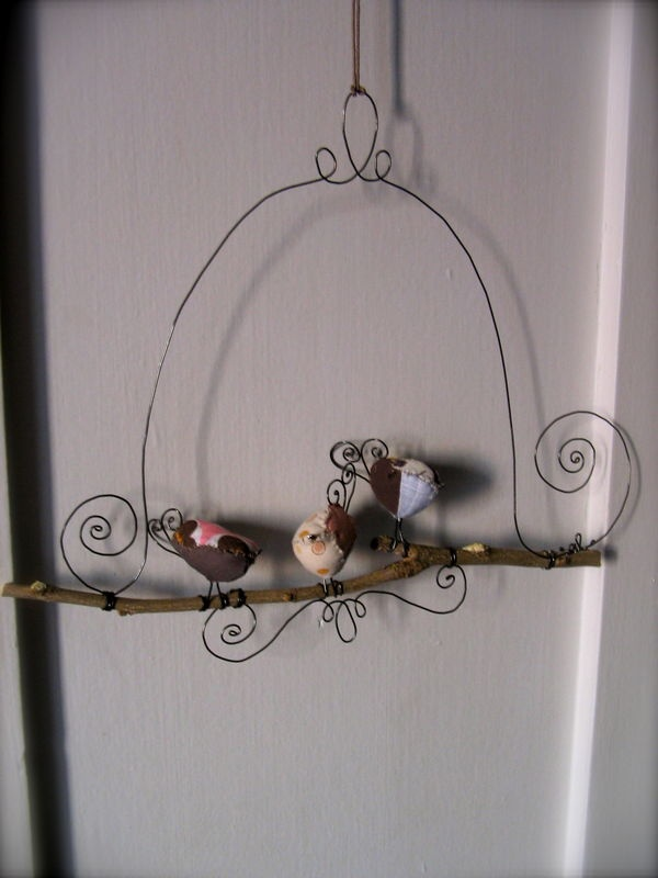 This is a cute way to display my painted rock birds.  Would even look nice in the garden.