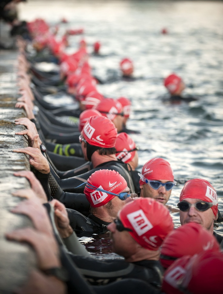 Swimmer take to the Wellington harbour before the hooter goes off