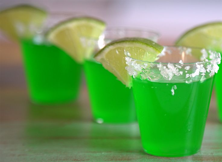 Let's Make: Margarita Jell-O Shots 2 packets of Lime Jell-O  1/2 cup margarita mix  1 cup boiling water  1/2 cup (ish) tequila  Sea Salt  Lime slices/lime juice