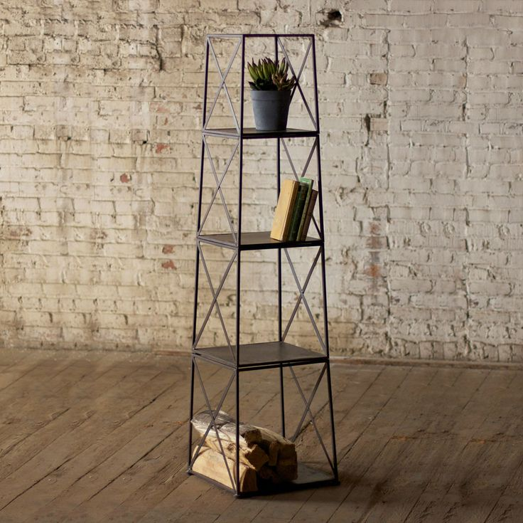 Books, potted plants, bath towels, you name it. They'll all have a new home with this four-tiered iron tower. Edgy lines give this industrialized piece an urban vibe—but not enough that it stands out t...  Find the Four-Story Iron Shelf, as seen in the Modern Vermont Cabin Collection at http://dotandbo.com/collections/modern-vermont-cabin?utm_source=pinterest&utm_medium=organic&db_sku=KLL0393