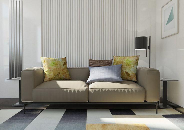Гостиная в современном стиле. Стена за диваном декорирована гипсовыми панелями.  Геометрический ковер в гостиной.
