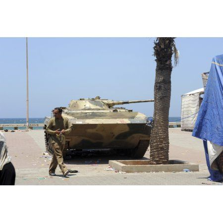 An old Russian BMP armored personnel carrier on the seafront in Benghazi Libya Canvas Art - Andrew ChittockStocktrek Images (35 x 23)