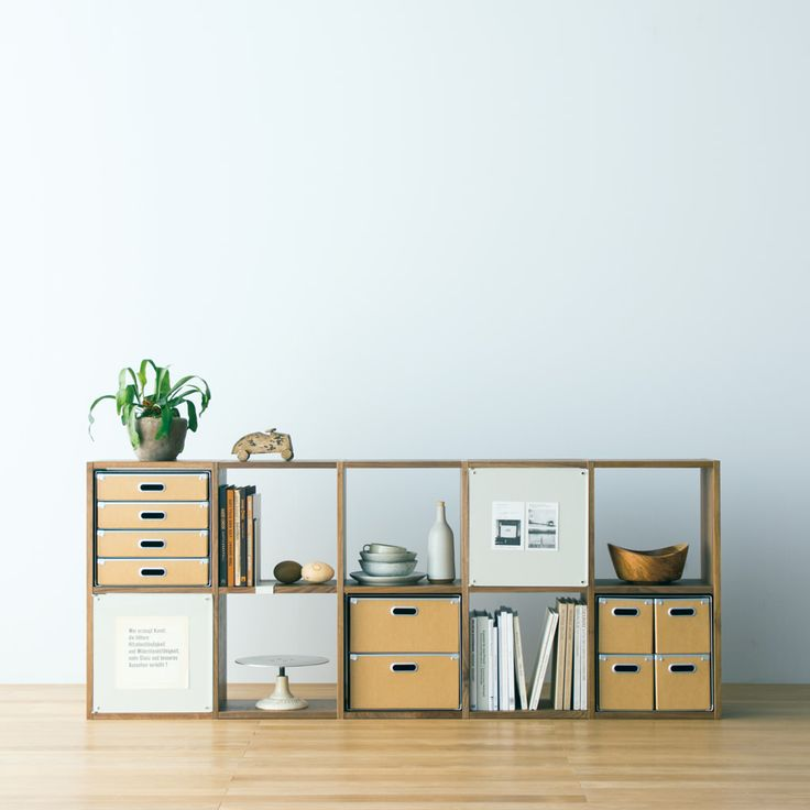 Compact Life | MUJI.  Love this idea of making one cubby hole into a wall for hanging art, notes, photos etc.