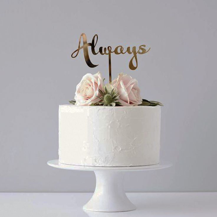 What kind of cake will you be having on your big day? A simple elegant Wedding cake with beautiful flowers to decorate  www.wed2b.co.uk