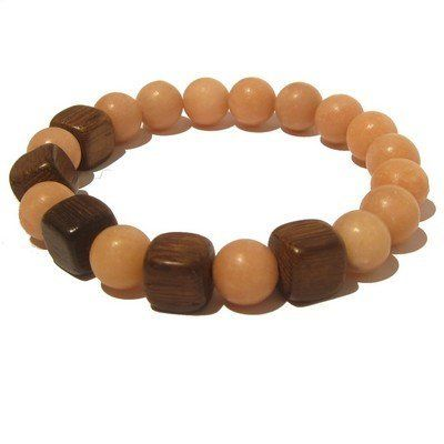 "Quartz Bracelet 18 Stretch Peach Brown Wood Cube Crystal Stone Gem Healing Bead I Dig Crystals. $30.00. Chakra: All. Quartz: master healing stone. This is an original piece handcrafted in the USA. Measures: approx 7""L x 10mm. One-of-Kind sold and created by Sheila Satin of I Dig Crystals"