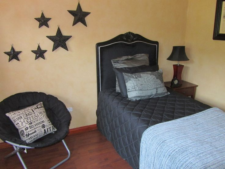 French headboard in a glossy black, perfect for a teenager!