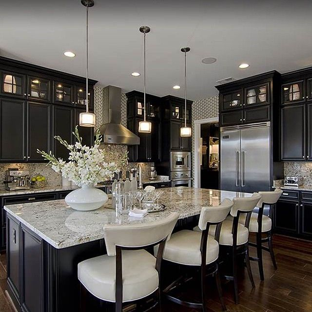 contemporary kitchen, love the dark warm cabinets with the contrasting counter and ding area.