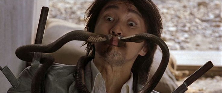 Stephen Chow, getting synchronized snake bites in his brilliant Kung Fu Hustle