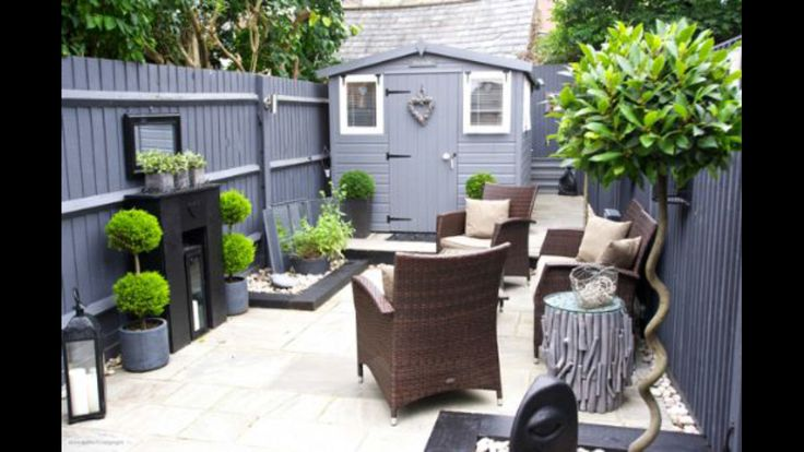 Cute back garden with grey paint