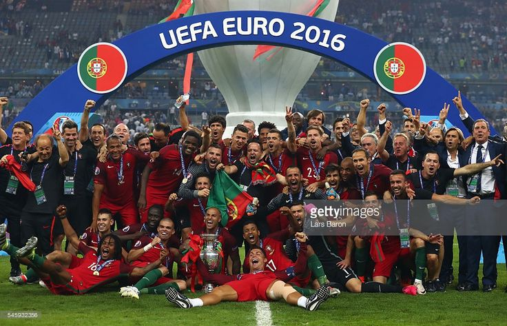 Portugal players and staffs celebrate after their 1-0 win against France in the UEFA EURO 2016 Final match between Portugal and France at Stade de France on July 10, 2016 in Paris, France.