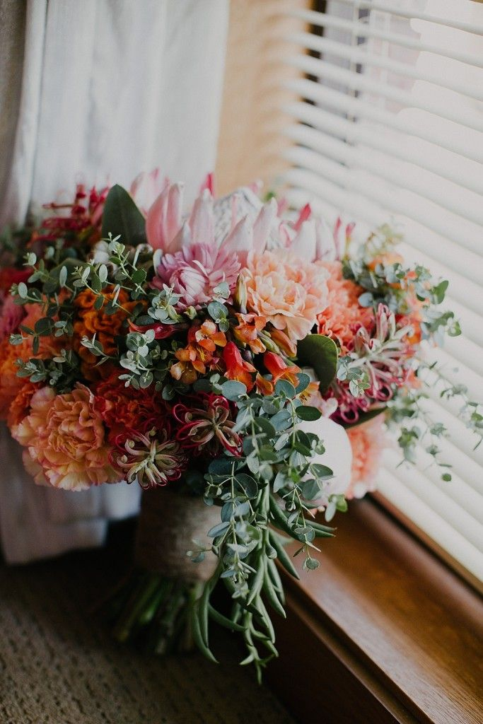A Blooming Brilliant Wedding - Bridal Bouquet, Bridesmaid's Bouquet, Buttonhole, Boutonniere, for Nicole and Hector. Including Tulips Paper Daisies King Protea Eucalyptus Gum Gumnuts  Carnations Snapdragons