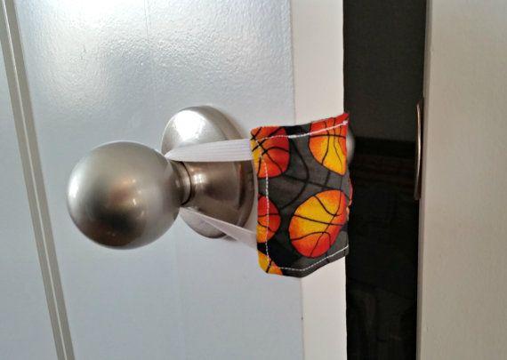 Sneaky Peek Basketball Nursery Door Muffler by PlaidPlatypusGifts