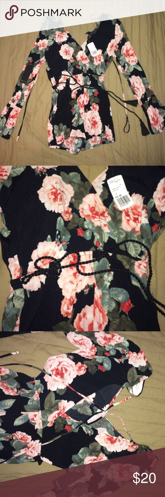 NWT F21 Floral Jumper 🎀❤ NWT F21 floral jumper with rope tie on the waist and cross back. Beautiful but too small for me, received as a gift. Fits like a boho top and short shorts. A great summer piece to show off 🎀❤🎉 Forever 21 Other