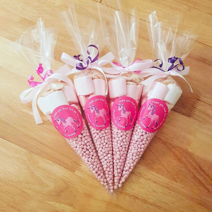 Birthday sweet cones custom made to your choice of sweets and chocolates. Made for any occasions. Advertised here are pink and white sweet cones for a girls birthday. Personalised with ribbon, initials, or birthday stickers.